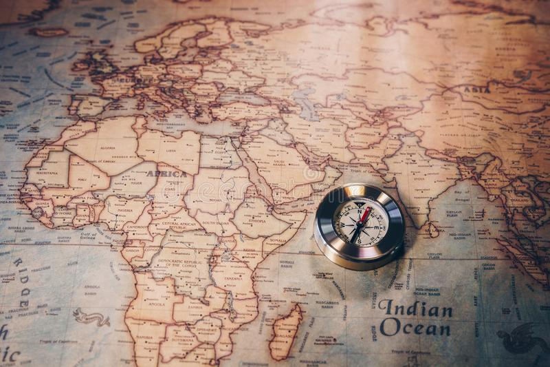 Travel concept background, vintage compas and old earth map.  royalty free stock photos