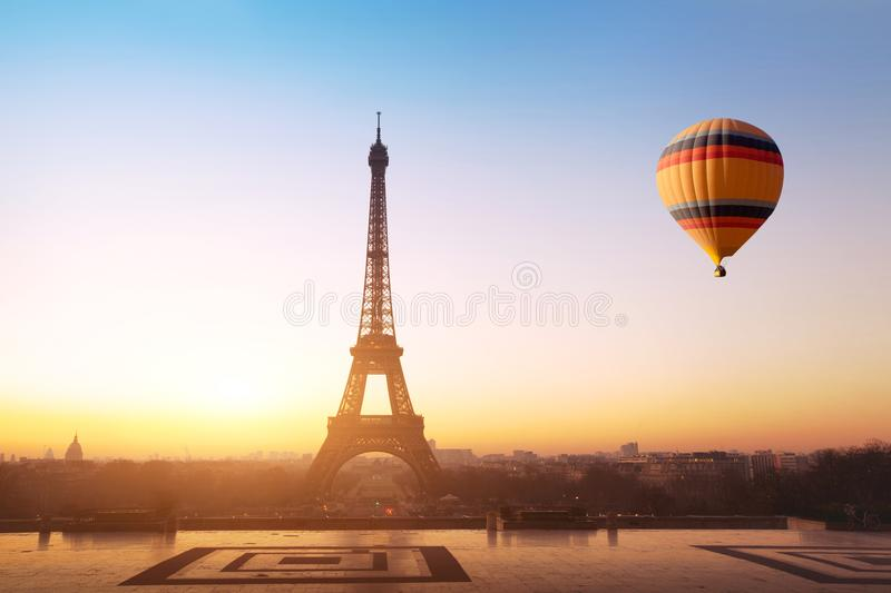 Travel concept, beautiful view of hot air balloon flying near Eiffel tower in Paris, France royalty free stock image