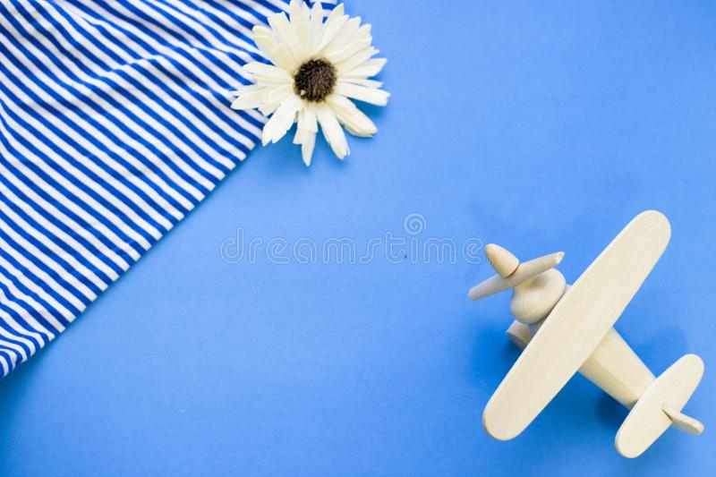 Travel concept blue background with beach essentials stock image