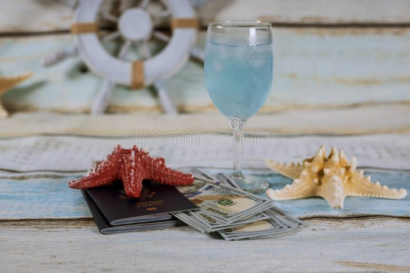Travel concept. Cruise on the ship. Glass of drink, passport, money stock photography