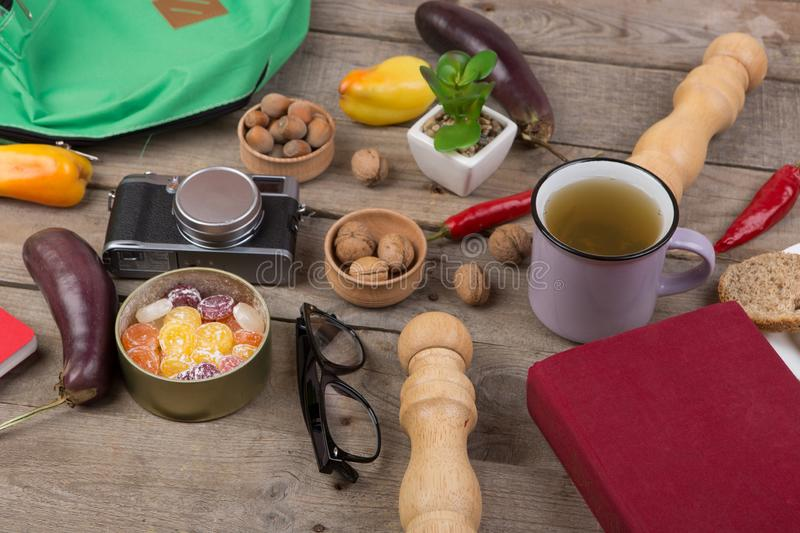 Travel concept - cup of tea, camera, glasses, vegetables, kitchen accessories, candies. Spring, autumn, eyeglasses, book, trip, background, brown, cafe, cold royalty free stock image