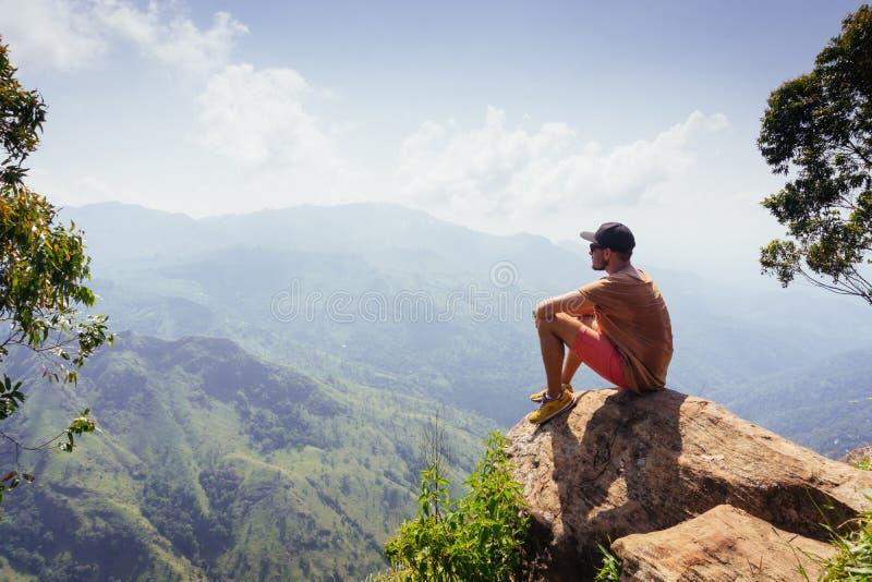 Travel concept. Male hiker on Ella Rocka enjoying mountain landscape, Sri Lanka. Travel concept. Male hiker on Ella Rocka enjoying mountainous nature landscape stock photography