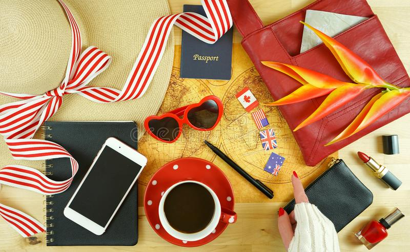 Travel concept planning with accessories and old pre-1900 map of the world. royalty free stock image