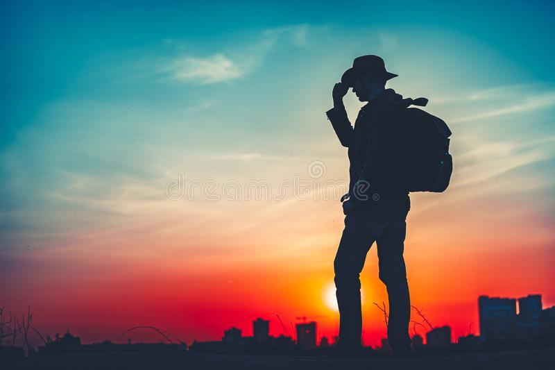 Travel Concept. Silhouette of a man with backpack stock photos