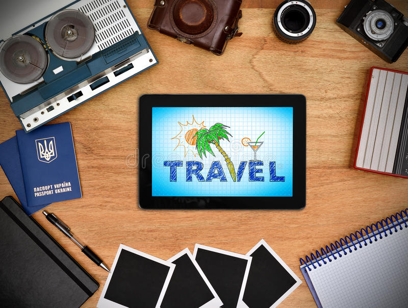 Travel concept. Touch pad with travel concept on blue screen royalty free stock photos