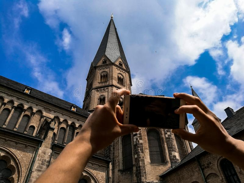 Travel concept - Tourist photographs tower stock photography
