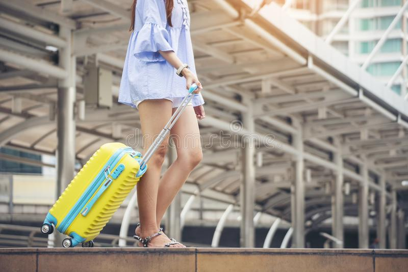 Travel concept.At train station,Young Tourist Girl walking,Dragging luggage suitcase bag and searching hotel.Asian women waiting royalty free stock photos
