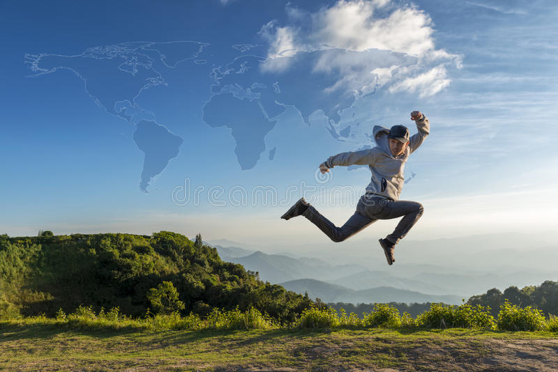 Travel concept,Traveler man jumping outdoor with map. Of world, concept of travel and happiness stock image