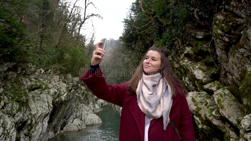 Travel concept. Woman taking selfie at Canyon Devil`s Gate in Sochi, Russia. stock images