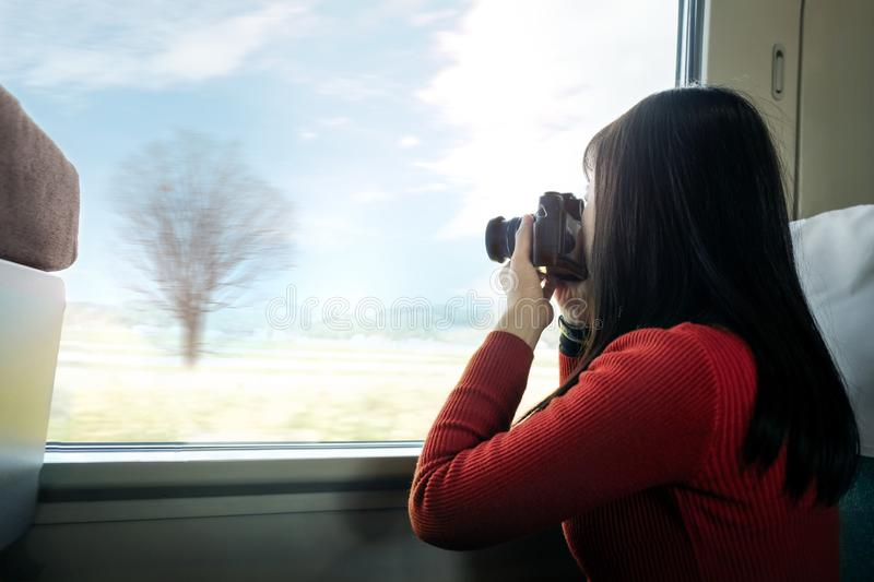 Travel Concept. Young Traveling Woman with Camera taking Photo royalty free stock photo