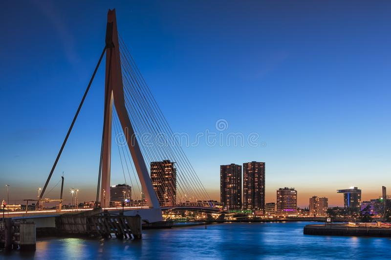 Amazing Cool View of Rotterdam Skyline with Erasmus Bridge on Foreground During Blue Hour. royalty free stock images