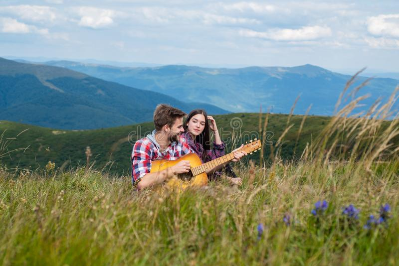 Travel couple enjoying wanderlust view, friends excitement at mountain background. stock image