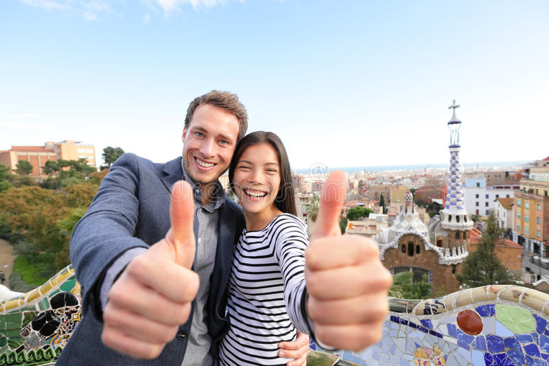 Travel couple happy in Park Guell, Barcelona stock photo