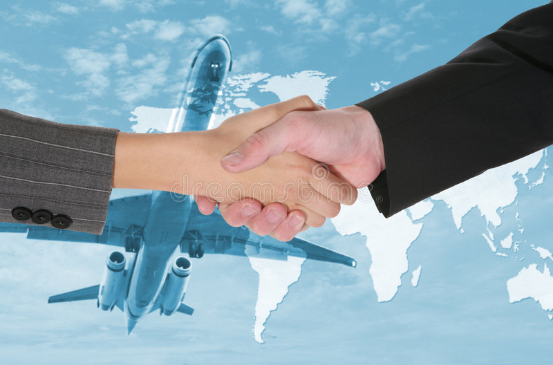 Travel Deal. Two business people shaking hands with a airplane and world map background stock image