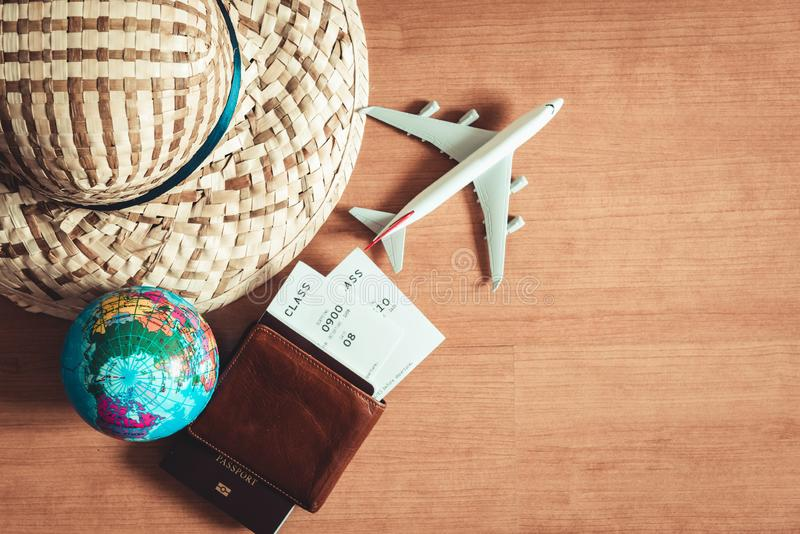 Travel destination explore planning on vacation trip., Layout of journey accessories with straw hat, pocket, passport, air ticket stock photos