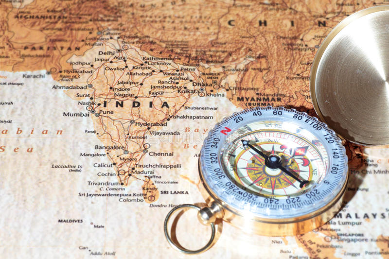 Travel destination india ancient map with vintage compass stock compass on a map pointing at india planning a travel destination gumiabroncs Images