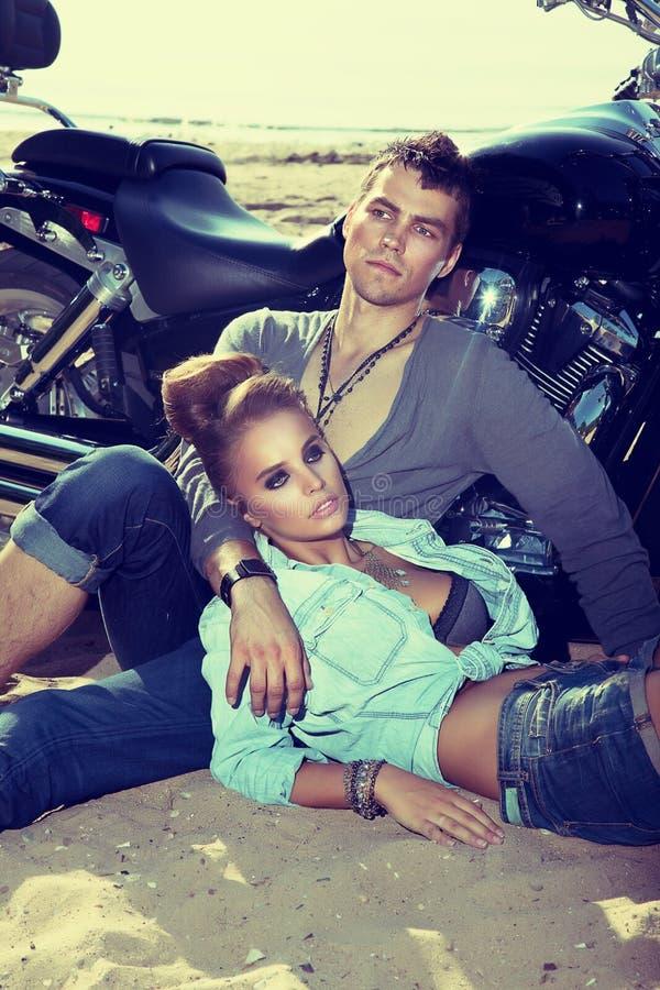 Travel destination.Man and woman resting.Motorbike stock photo