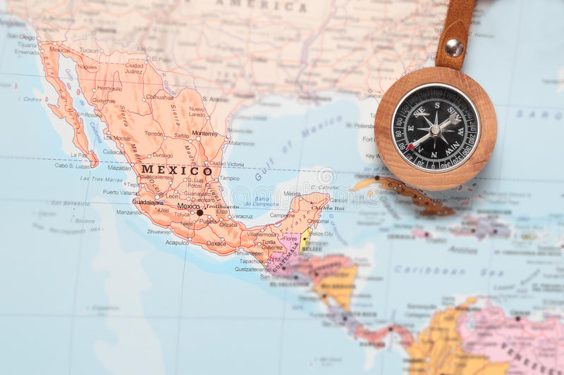 compass on a map pointing at mexico and planning a travel destination