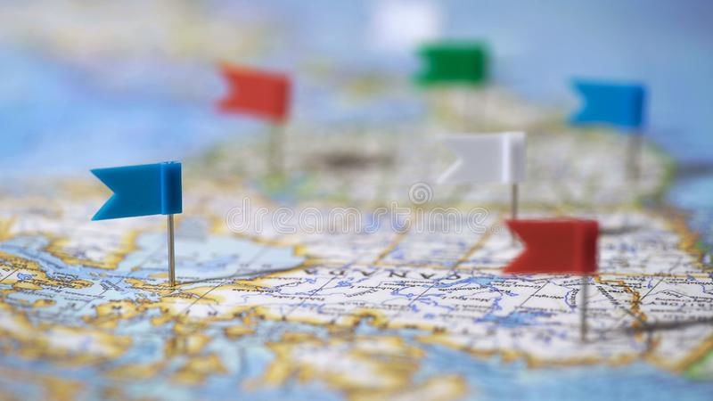 Travel destinations in Canada marked with pins on world map, tourism, closeup. Stock photo royalty free stock photo