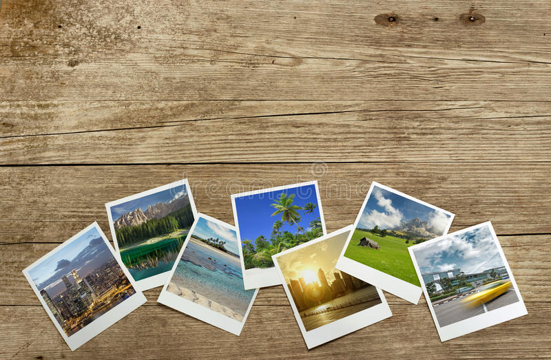 Travel destinations. Snapshots of travel destinations on wooden background royalty free stock images