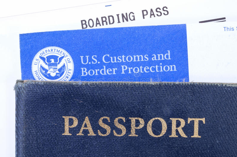 Travel documents. ATLANTA, USA - DECEMBER 11, 2014: Americans traveling abroad need a valid U.S. passport and a completed customs declaration form when returning stock images