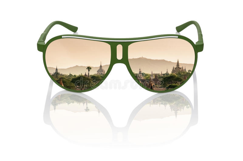 Travel dreams. Antique bagan temples at sunset reflection in sunglasses on white background. Asian travelling stock photography