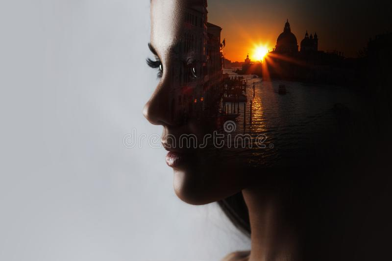 Travel dreams, concept. The profile of the girl and the sunset in a beautiful location. Double exposure stock images
