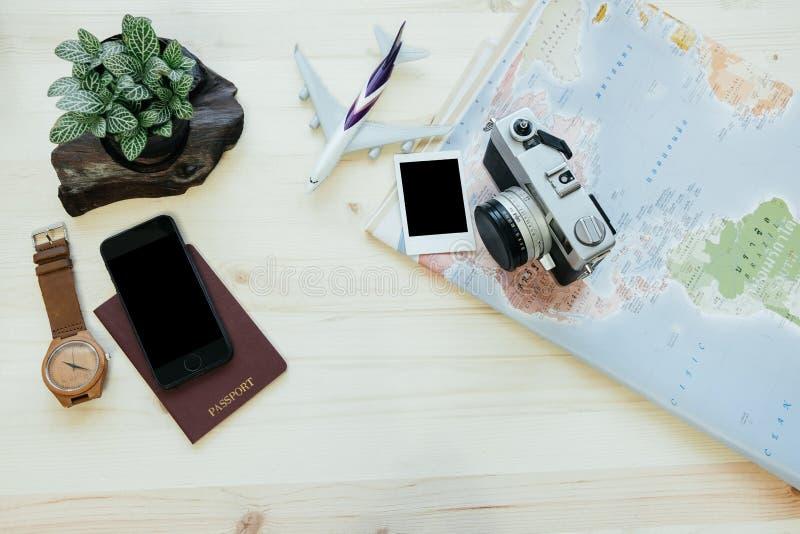 Travel equipment include map, passport, camera, smart phone, air. Travel equipment include world map, passport, camera, smart phone, airplane, smart phone, photo royalty free stock photos