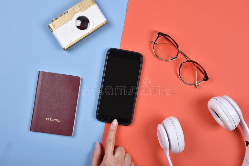 Travel essentials preparation, Hand touching blank smartphone screen for mock-up, Travel accessories. royalty free stock photography