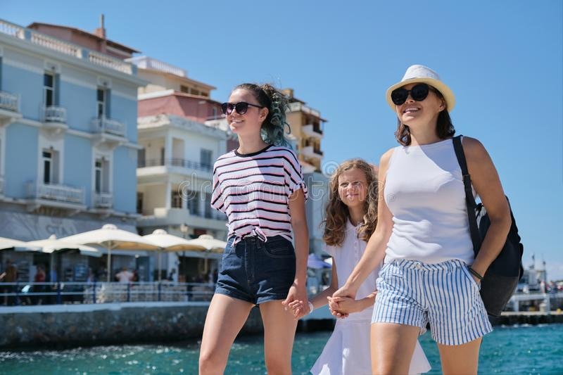 Travel Europe summer holiday family mother and daughters holding hands royalty free stock photo
