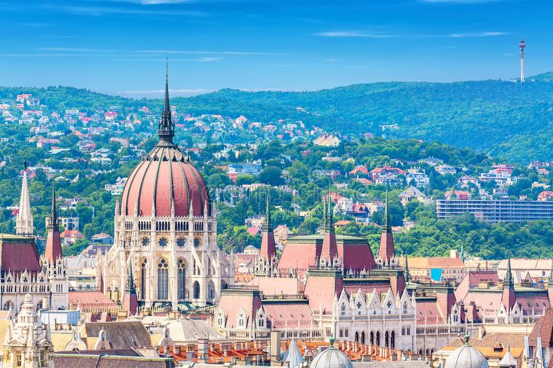 Travel and european tourism concept. Parliament and buda side panorama of Budapest in Hungary during summer sunny day with blue sk. Y and clouds. View from Saint royalty free stock photo