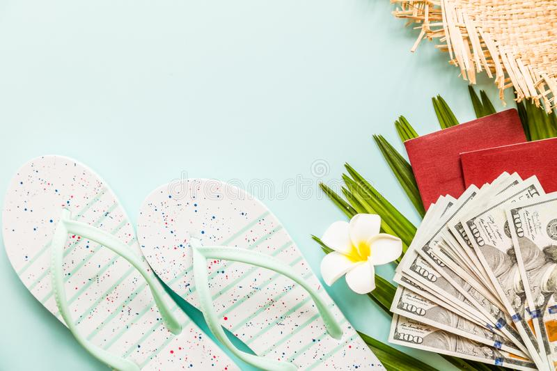 Travel flat lay items: fresh pineapple, flower, cash money, passport,, beach slippers and palm leaf. Place for text. Top view stock photography