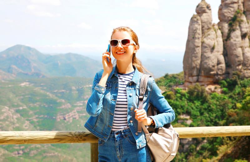 Travel happy smiling woman talking on a smartphone over mountain. Spain background stock images
