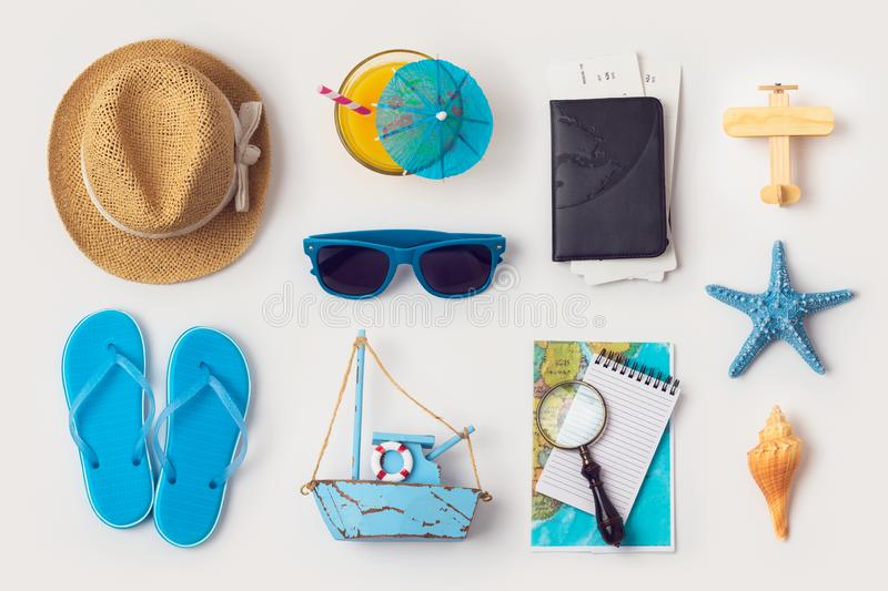 Travel holiday vacation concept with beach and travel items organized on white background. Top view from above. Flat lay stock photos