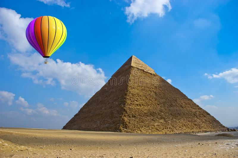 Travel, Hot Air Balloon, Egypt, Pryamid. A hot air balloon is flying by the Great Pyramid of Giza in Cairo, Egypt. Travel, holiday and vacation travel concept stock photos