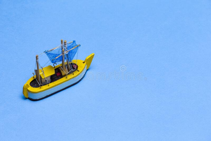 Travel Ideas and Concepts. Model of Wooden Old Sailboat Placed Over water Blue  Background royalty free stock images