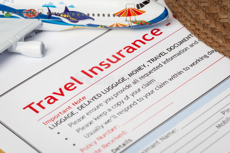 Travel Insurance Claim application form and hat with eyeglass on royalty free stock image