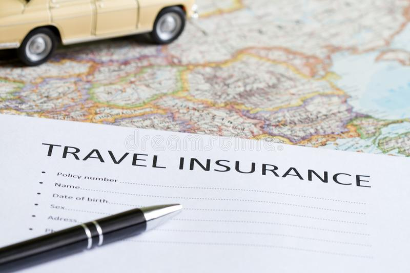 Travel insurance concept with car and map. Abstract royalty free stock photo