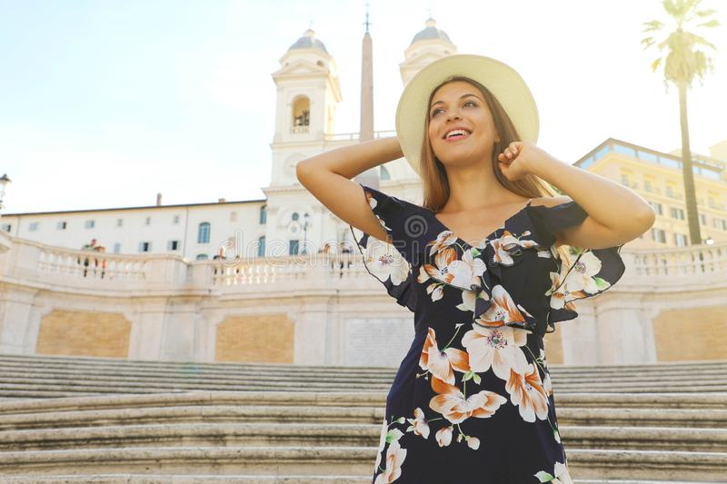 Travel in Italy. Beautiful young woman on the Spanish Steps famous landmark of Rome. Summer holidays in Europe royalty free stock image