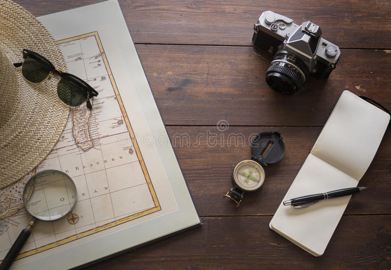 Travel items with map and camera royalty free stock image