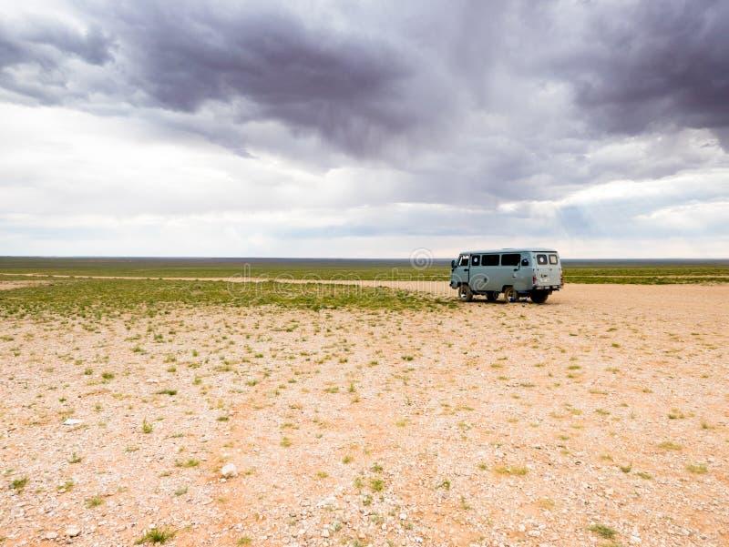 Adventure travel in Mongolia desert of Gobi. Travel with land vehicle in Mongolia desert of Gobi royalty free stock photos