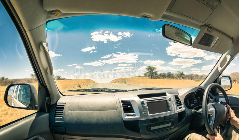 Travel landscape from a car cockpit - Concept of adventure trip. On the road to exlcusive destinations - Fisheye view on desert street and cloudscape during stock photos