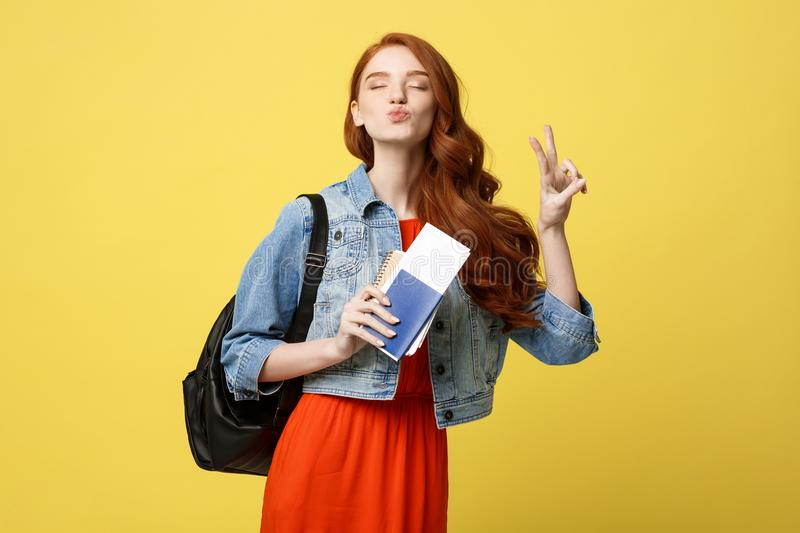 Travel and Lifestyle concept: Full length studio portrait of pretty young student woman holding passport with tickets stock images