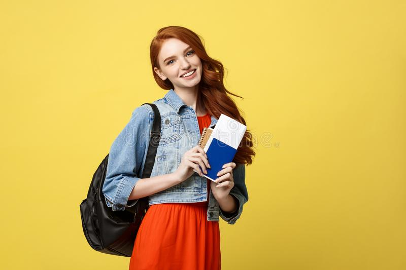Travel and Lifestyle concept: Full length studio portrait of pretty young student woman holding passport with tickets royalty free stock images