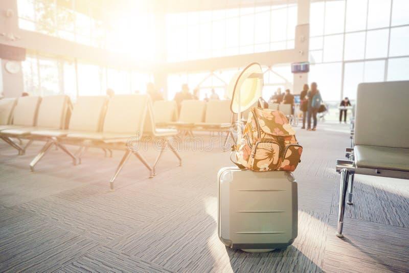 Travel luggage with passenger. Blur background stock photo