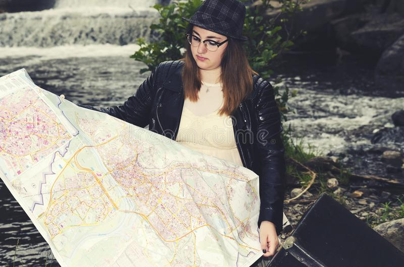 Travel Map Girl Hat Suitcase Waterfall royalty free stock image