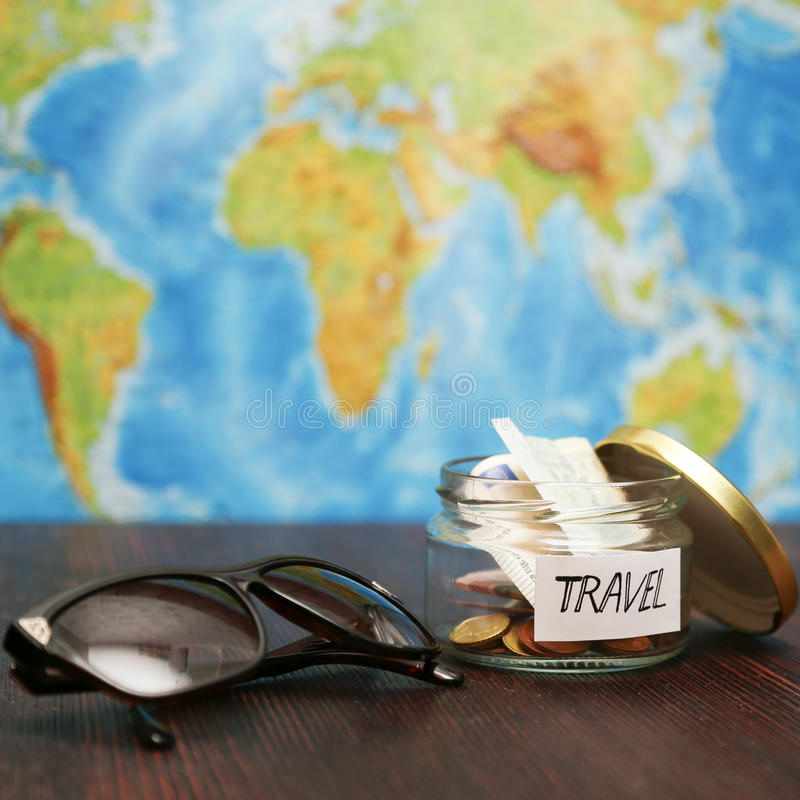 Travel money in jar sunglasses world map at background stock download travel money in jar sunglasses world map at background stock image gumiabroncs Gallery