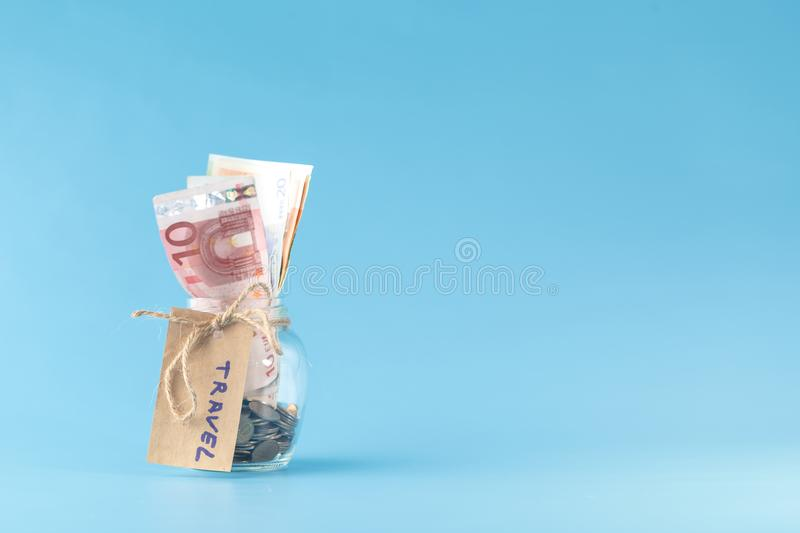 Travel money savings in a glass jar stock photos