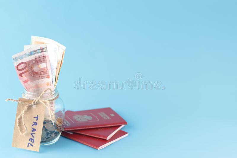Travel money savings in a glass jar stock photography