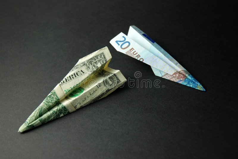 Travel Money (US Dollars & Euros). Two paper planes made from an American $1 bill and a €20 note royalty free stock photography